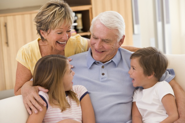 Grandparents laughing with grandchildren